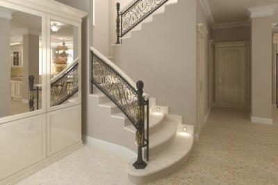 Интерьер холла с лестницей в светлых тонах